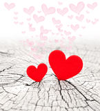 Red hearts. On a wooden background stock photography