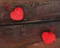 Red hearts on wooden background. Royalty Free Stock Photography