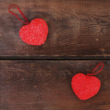 Red hearts on wooden background. Stock Images