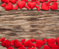Red hearts on a wooden background royalty free stock image