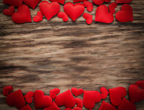 Red hearts on a wooden background stock photography