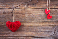 Red hearts on wooden background. Toned, soft focus, copy space Royalty Free Stock Image
