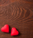 Red hearts on wooden background Stock Image