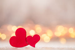 Red hearts on the wooden background. Stock Photos