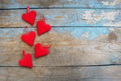 Red hearts on wooden background.Valentines day greeting card.Top view with copy space. Red hearts on wooden background.Valentines day greeting card Royalty Free Stock Photo