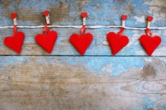 Red hearts on wooden background.Valentines day greeting card.Top view with copy space. Red hearts on wooden background.Valentines day greeting card Stock Photos