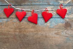 Red hearts on wooden background.Valentines day greeting card.Top view with copy space. Red hearts on wooden background.Valentines day greeting card Royalty Free Stock Photos