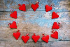 Red hearts on wooden background.Valentines day greeting card.Top view with copy space. Red hearts on wooden background.Valentines day greeting card Royalty Free Stock Image