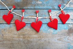 Red hearts on wooden background.Valentines day greeting card.Top view with copy space. Red hearts on wooden background.Valentines day greeting card Stock Image