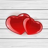 Red hearts on wooden background Stock Photography