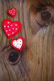 Red hearts on  wooden board Royalty Free Stock Images