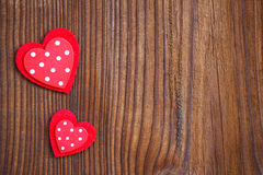 Red hearts on  wooden board Stock Photos