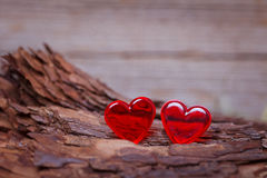 Red hearts on wooden board Royalty Free Stock Image