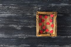 Red hearts in a wooden box, top view. space for text royalty free stock photos