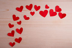 Red hearts on a wooden table. Little red hearts on a wooden table Stock Photo