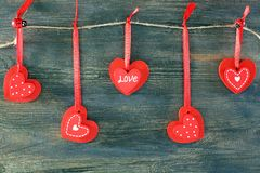 Red hearts on a wooden wall. Stock Photography