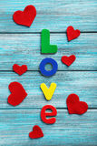 Red hearts and word Love Royalty Free Stock Photography