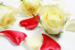 Red hearts and yellow roses Royalty Free Stock Image