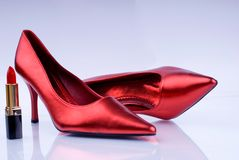 Red heat. High heel shoes and lipstick - female weapon royalty free stock photos