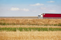 Red heavy truck on the road. Delivery cargo logistic. Spain Royalty Free Stock Image