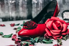 Red heels and red rose on white and grey background. stock images