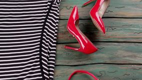 Red heels and sunglasses. stock footage