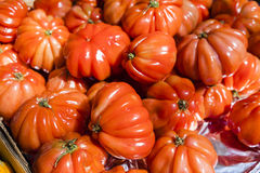 Red heirloom tomatoes in a market in Paris, France Royalty Free Stock Images