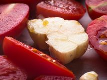 Red heirloom tomatoes with olive oil. Red heirloom tomatoes ready to be baked with olive oil stock photography
