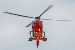 Red helicopter. Red air ambulance helicopter flying towards you stock photo