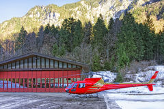 Red helicopter at alpine heliport Royalty Free Stock Photography