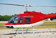 Red helicopter on the ground Stock Photo