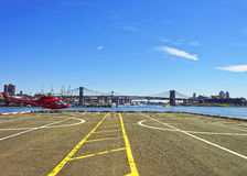 Red Helicopter on helipad in Lower Manhattan of New York Stock Photography