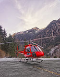 Red helicopter in heliport at swiss alps 2 Stock Photography
