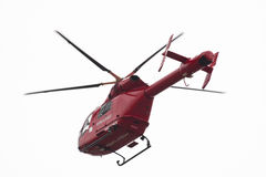 Red helicopter of air ambulance isolated on white background, London - UK Stock Photo