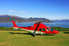 Red helicopter on the landing field. Royalty Free Stock Photos