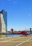 Red Helicopter landing on helipad in Lower Manhattan New York Stock Image