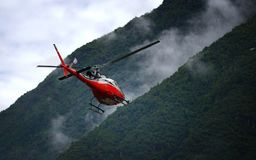 Red Helicopter Leaving Tenzing–Hillary Airport.  stock photography