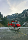Red helicopter at mountain heliport at swiss alps Royalty Free Stock Photos