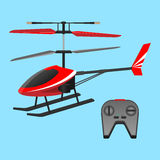 . Red helicopter plaything and black small control panel with buttons. Royalty Free Stock Image