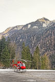 Red helicopter at swiss mountain heliport Stock Images