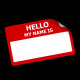 Red Hello My Name is Sticker. Red name tag or sticker with words Hello My Name is with bent corner on black Royalty Free Stock Photos