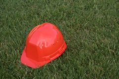 Red Helmet. Red safety hat royalty free stock photo