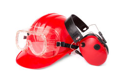Red helmet with ear protectors and fathers Royalty Free Stock Image