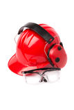 Red helmet with ear protectors and fathers Stock Images