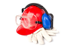 Red helmet with leather gloves and earmuffs eyes Royalty Free Stock Image