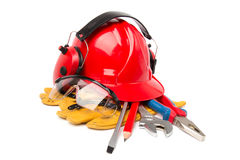 Red helmet with leather gloves and earmuffs tool Royalty Free Stock Image