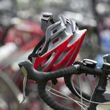 Red helmet resting on handlebars Royalty Free Stock Photography