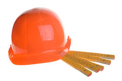 Red helmet and rulers Stock Images