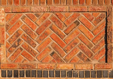 Red Herringbone brick wall seamless background Stock Photos