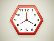 Red hexagonal clock Stock Image